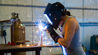 Andrew Murdoch welds metal bases for a project.