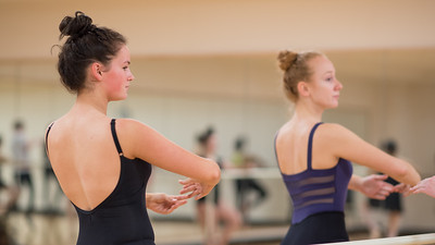 Students Siobhan O'Reilly (left) and Allison McCaughey practice during Ballet I.