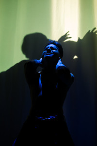 Angel, played by actor Thomas Valdez, Sings during the musical number, Contact, from Rent.
