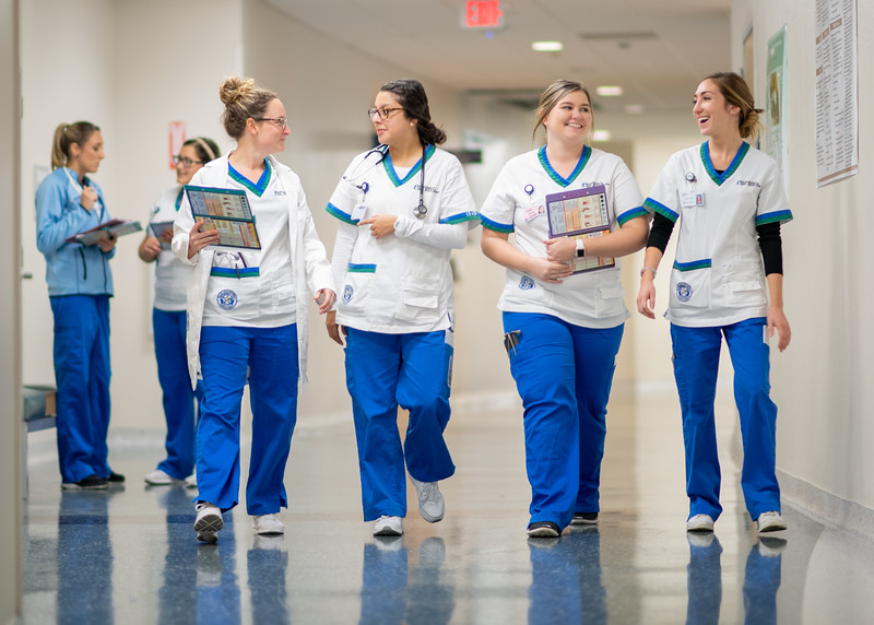 Nursing students make their way to their lab on the second floor of Island Hall.
