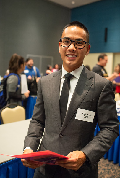 Upcoming Nursing Graduate  of Fall 2018 Kevin Wang poses for photo at this years Nursing and Health Sciences Expo in the University's Center LoneStar Ballroom.