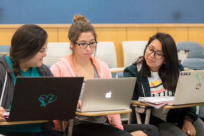 Amy Alonso (left), Valerie Salas, and Jessica Facundo review notes during their Professional Transitions of Nursing class.