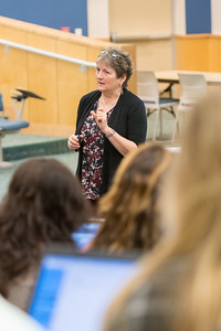 Professor Susan Greathouse gives a lecture during her Professional Transitions of Nursing class.