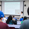 Students take notes during a lecture on Biological Theories.