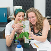 Carissa Piñõn and Ashley Hamilton color match the leaf colors to check for the plant's health during Plant Form and Function.