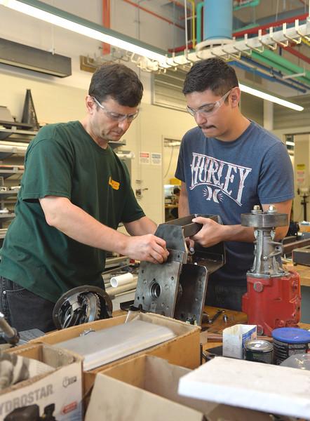 Dr. Petru Aurelian Simionescu assists senior student Josh Chapa with his Basisc Utility Vehicle capstone project.