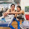 Gypsie Alvarado (left), and Arianne Anes work on their Aqua Bot capstone project in the Engineering lab.
