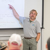 Dr. Andrew Conkey reviews problems with his students during his Dynamics course.