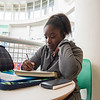 Sabrynna Cox focuses on completing her Chemistry assignments in University Center.