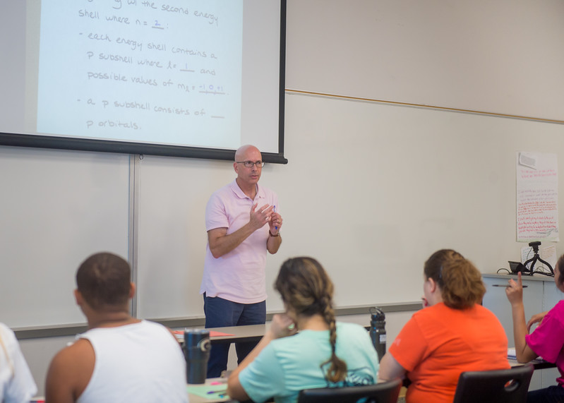 Dr. Silliman takes questions from students regarding energy shells in his General Chemistry I class.