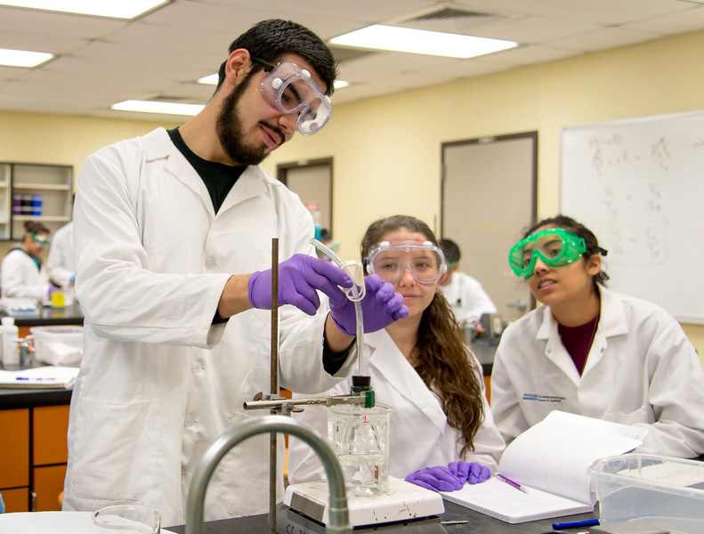 Students Martin Saldona, Crystal grace Burns and Martin Saldona do their experiment in General Chemistry lab