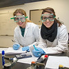 Students Andrea Castro and Cheyenne Kemnitz calculate their lab result in General Chemistry I lab.