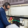 Lab instructor Dr. Marquez Gonzalez assists a student in the Organic Chemistry lab.