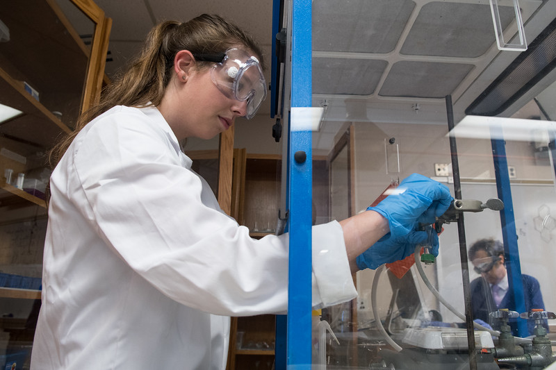 Callie Ehlinger concentrates on her experiment in Organic Chemistry II.
