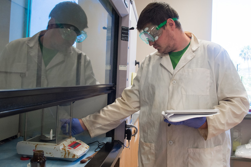 Mason Miller works on his experiment in Organic Chemistry II.