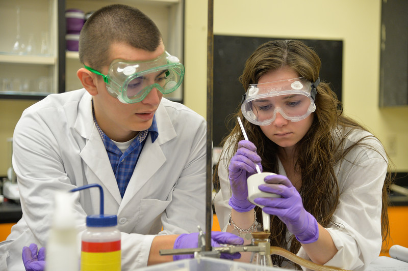 Student Mark Rolph(left) and Mark Mcmoney Work on chemical analysis Titration of a Weak Acid with a Strong Acid in general chemistry lab.