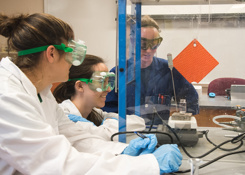 TAMUCC Professor Jenna Cooper assists her students through their organic chemistry experiment.
