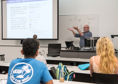 Mr. Mark McKay delivers a lecture about the heat capacity of water during an Oceanography class.