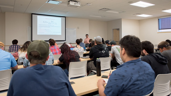 Dr. Xie explains different functions to his students during his Climate and Climate Variability course.