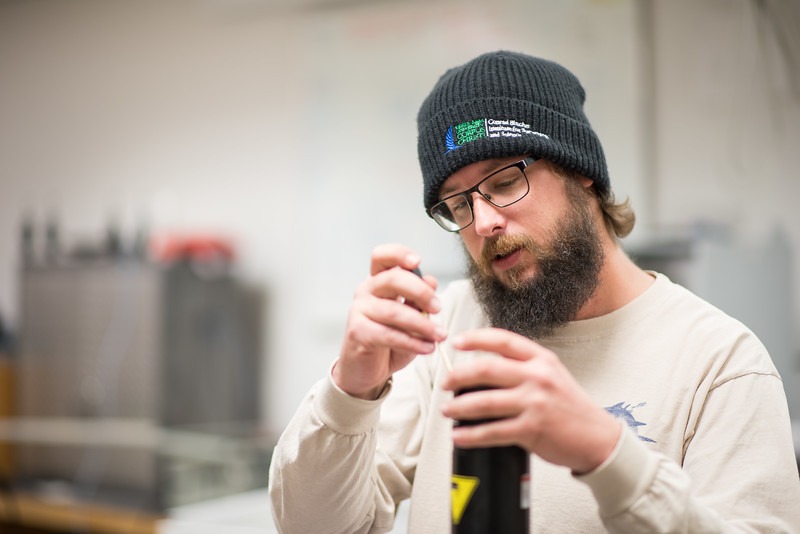 Research engineer associate Hugo Mahlke works on testing, and assembling a NORTEK Aquadropp module prior to installing it on site.