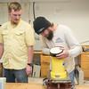 Research Engineer Associates Hugo Mahlke (left), and Brian Lorentson prepare a SonTek ADP module in the Conrad Blucher Institute labs.
