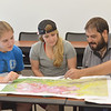 Students Dani Orrell(left), Alannah Gonzalez and Jorge A. Gonzalez discuss about their assignment in their Geological Field Method class.