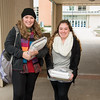 Katherine Cade (left) and Amanda Liserio stop for a photo after getting their textbooks and school materials for the spring semester.