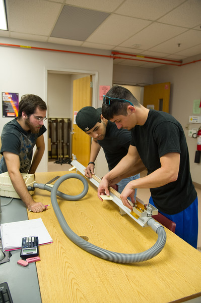 Joseph Olivarez, Jose Gutierrez and Hunter Johnson work together to find the acceleration of the subject.