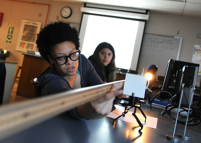 Physic student Arieal Leblane  mesuares the distance from opstic lense to object in Light Refraction lab.