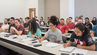 Students in Business Calculus take a quick break from taking notes to take a photo.
