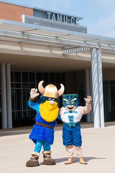 Del Mar College's Valdar the Viking (left), and Texas A&M University-Corpus Christi's Izzy the Islander.