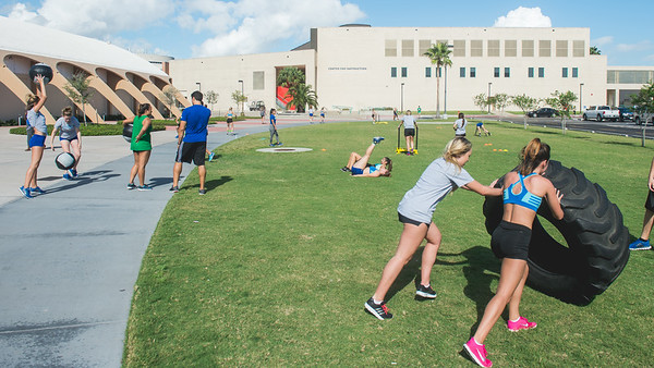 The cheer and dance team run their weekly Friday circuits in the Curlew Plaza field.