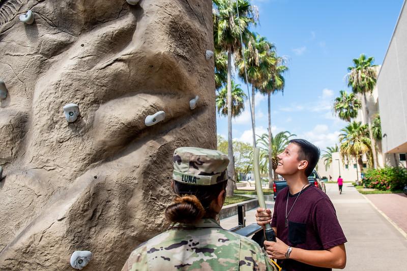 Austin Duchesneau prepares to climb the rock wall provided by the Army ROTC Islander Battalion.