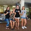 Student members of The Net, Kelsie Ives,  Leah Jackson, Faith Veroneau and Ellie Gonzales, pass out flyers to students walking through the spine