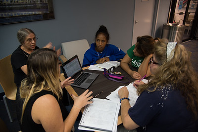 Students Amanda Hullum, Dora Jalamantes, Flor Aranda,Kerry G.,Joyce Swain discuss a assignment in the Mary and Jeff Bell Library on November 1, 2016