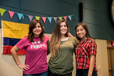 Karla Zamora, Patricia Galbraith, and Andrea Barrendey pose for a photo at the Colombian Carnival in the University Center.