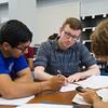 Marcos Rodriguez(left), Lane Cosper and Pearce Bennett work together on Algebra problem in Casa.