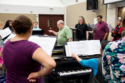 Dr. Bernhardt leads a group of vocalists through a composition in the Center for the Arts.