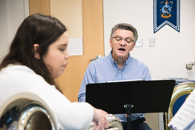 Dr. Dan Sipes provides feedback to student Christina Gonzalez during their tuba ensemble session in Bay Hall.