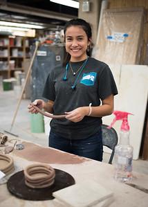 Esperanza Gomez creates clay coils during Ceramics I
