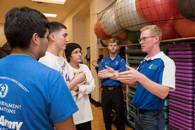 Colin Orand (right) explains rules to students during the Summer Prep Academy team building exercise.