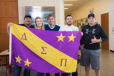 Members of Delta Sigma Pi gather in the O'Connor building to inform other students about their organization.
