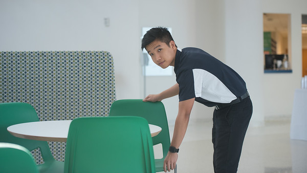 Student worker Duy Pham straightens up in the University Center.