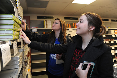 Students Jessica Brandt and Amber Otholt find textbook for the new semester.