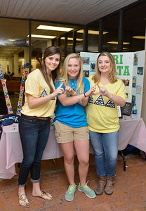 Members of Tamucc Delta Delta Delta Taylor Fuechec, Natalie Malhgut and Mckenzie Sluder pass out information about Spring 2015 Recruitment.