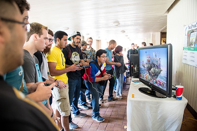 Students play a game of Super Smash Brothers between classes, event was hosted by Chi Alpha faternity.