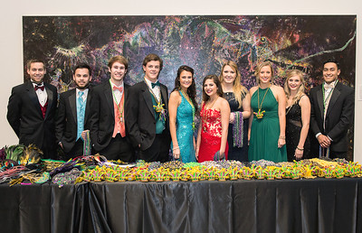 TAMU-CC islander ambassadors smile after helping guesses at President's Mardi Gras Ball.