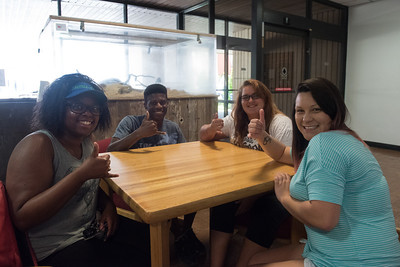 Ashley Cooper (left), Devin Farell, Katherine Searey, and Elayne Brocks hang out before class in the Center for Science.
