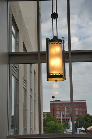 This is a reproduction of the historic light fixtures that hang in the original corridors. It is in the stairwell on the south side that goes down to the lower level. By December we will have these in the technology corridor outside the trading room and the student center.