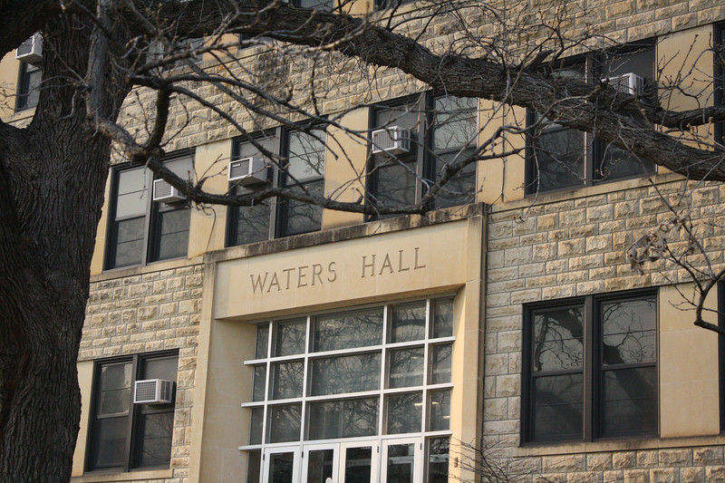 As one of the older buildings on campus, Waters Hall has its name inscribed above the main entrance on the Kansas State campus on April 5, 2019. (Dene Dryden | Collegian Media Group)